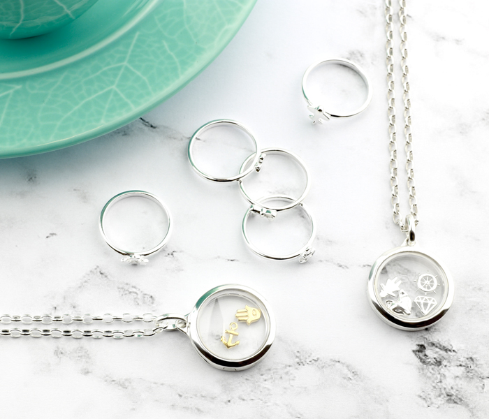 Silver Rings and 22mm Lockets with Various Charms